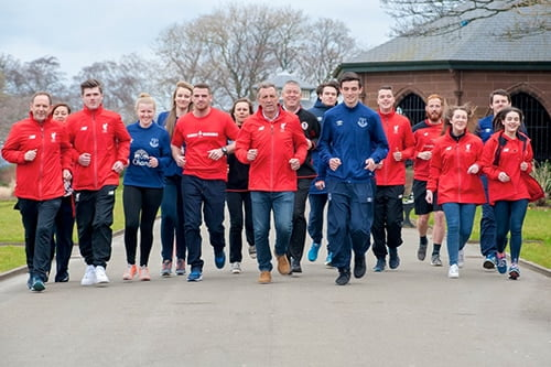 Alan Kennedy & Kurtis Stacey run with the charity teams. Credit: Paul Francis Cooper