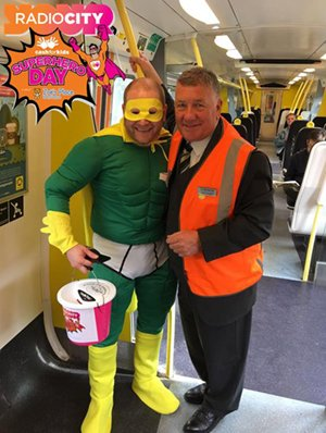 Scott Hughes on a Merseyrail train